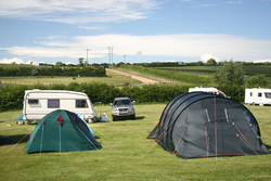 Image: Tents and caravans at Bagwell Farm Touring Park, Weymouth, Dorset
